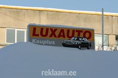 Lux Auto valgusreklaam maja katusel